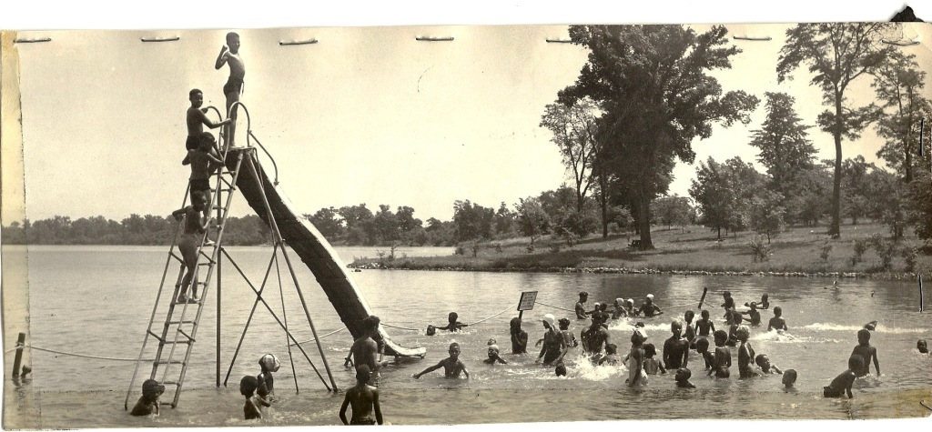 Children, and a few adults, enjoy Bridgeview Beach in 1942. (Sangamon Valley Collection)