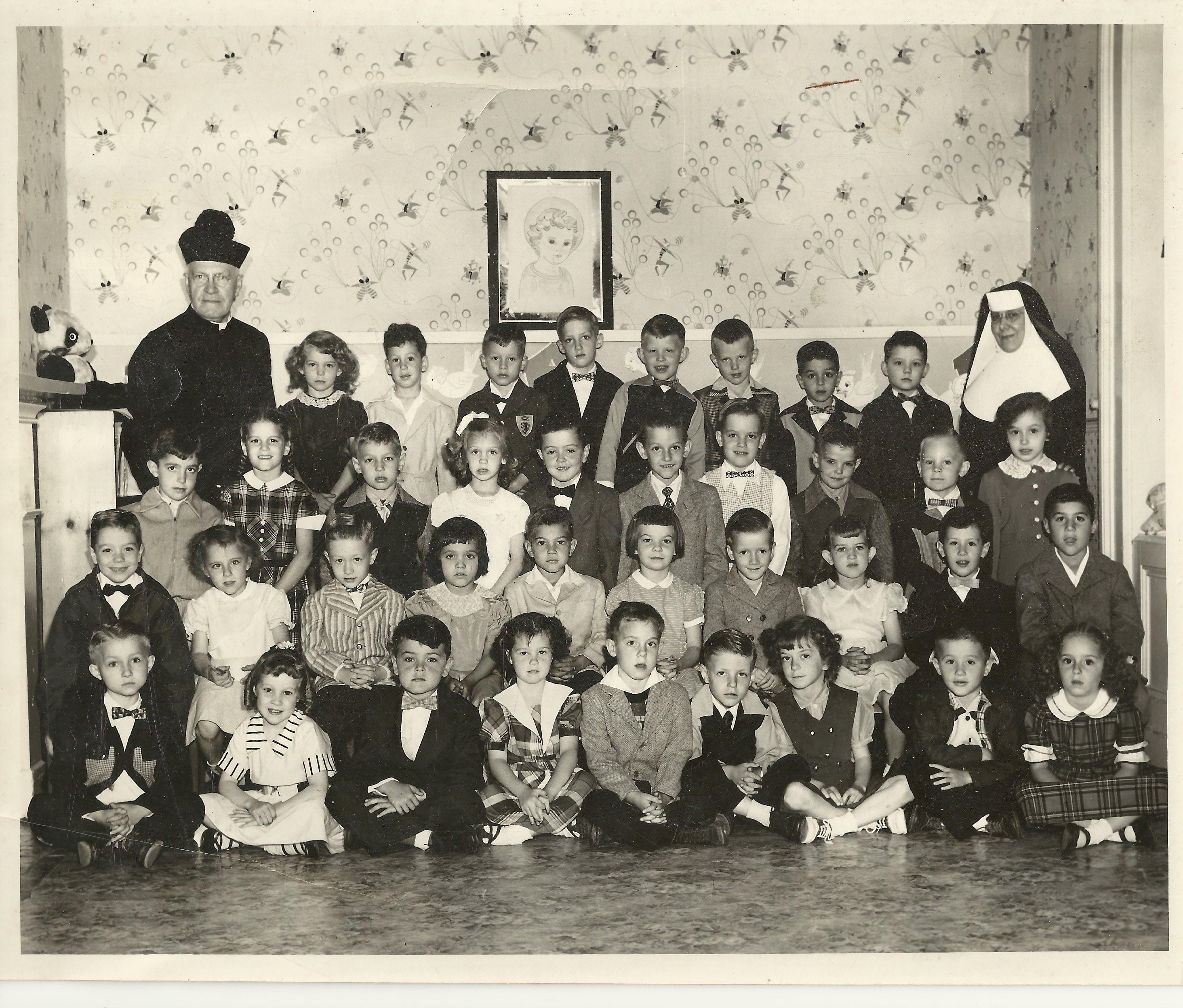 Kidergarten class, St. Peter & Paul School, 1952-53. Msgr. Linus Kipping (1864-1960). left; Mother Perpetua, right. (Photo courtesy Charles Tisckos)