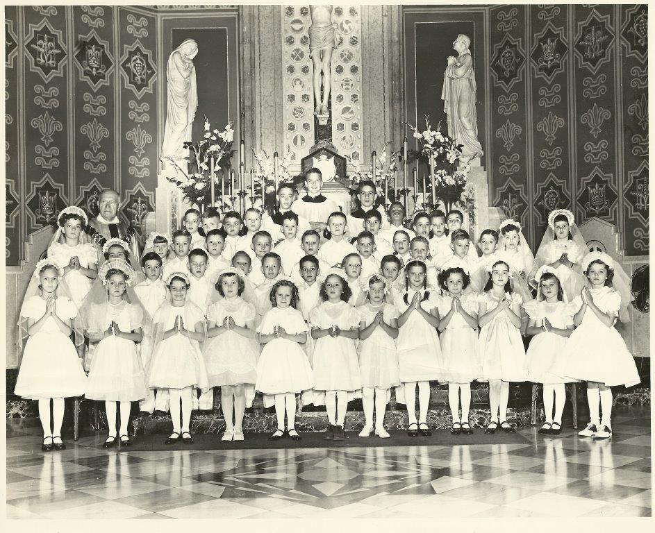 1955 First Communion class photo shows more detail of altar at St. Peter & Paul Church. Msgr. Linus Kipping, left. (Courtesy Charles Tisckos)