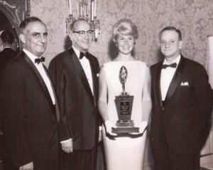George Gus Kerasotes, right, son of Gus Kerasotes,presents Doris Day with the 1961 Star of the Year award from the Theatre Owners of America. (Contributed by Mike Kerasotes)