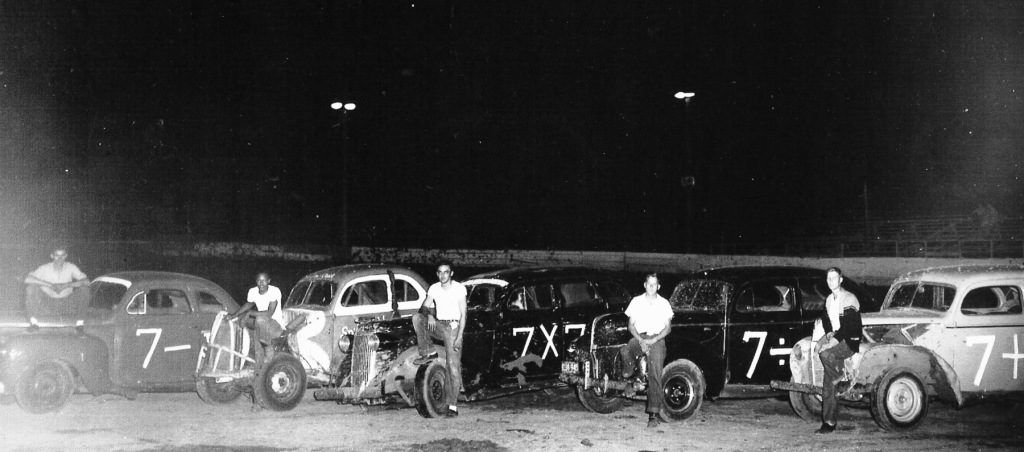 Shaheen's Springfield Speedway, 1955 . From left: Norm Scantlin, Chuck Hubbard, Jim Brown, Bob Sager, Art 'Buster' Zellers. Hubbard was the first African-American driver to make a bid in local stock car racing. (Sangamon Valley Collection)