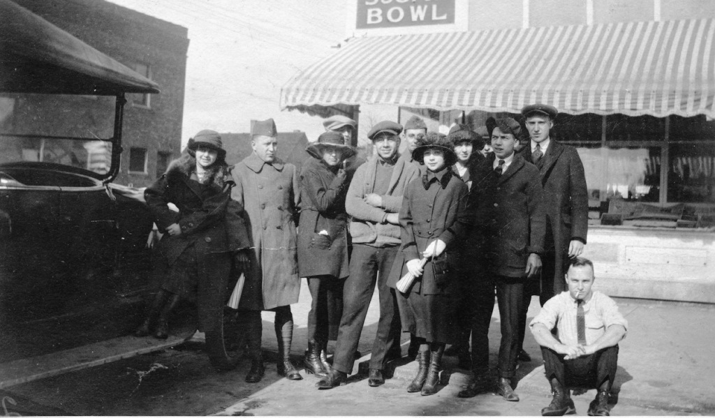 Group celebrating Armistice Day in front of the Sugar Bowl, November 11, 1920. They are at the corner of 11th Street and South Grand Avenue.