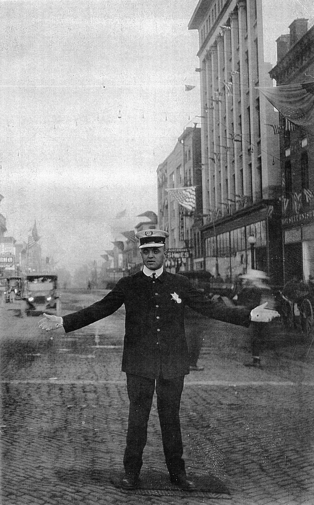 Springfield Police Officer Porter Williams directs traffic, 1916 (Sangamon Valley Collection)
