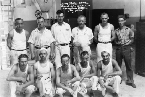Workers inside Amrhein Bakery, circa 1935. First row, from left, Harry Monroe, Joe Koehl, Richard Kaylor, Gus Gerst, Fritz Shea, Al Zimmerman; second row, Neil Thomas, Stew Spencer, Cecil Thomas, Frank Renz, Fred Dehner, Russell Hines; third row, Frank Whitmore, Merritt Cherry. (Photo: Archives of Bob Krotz, former Amrhein driver)