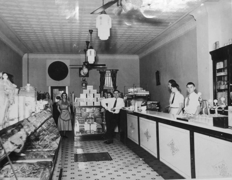 Alex Karon, leaning on counter, with employees of the State Street Sugar Bowl in early 1930s (Sangamon Valley Collection)
