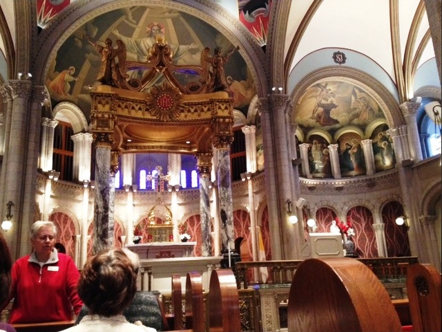 Sr. Renita Brummer (in red) guiding tour of St. Francis of Assisi Church.