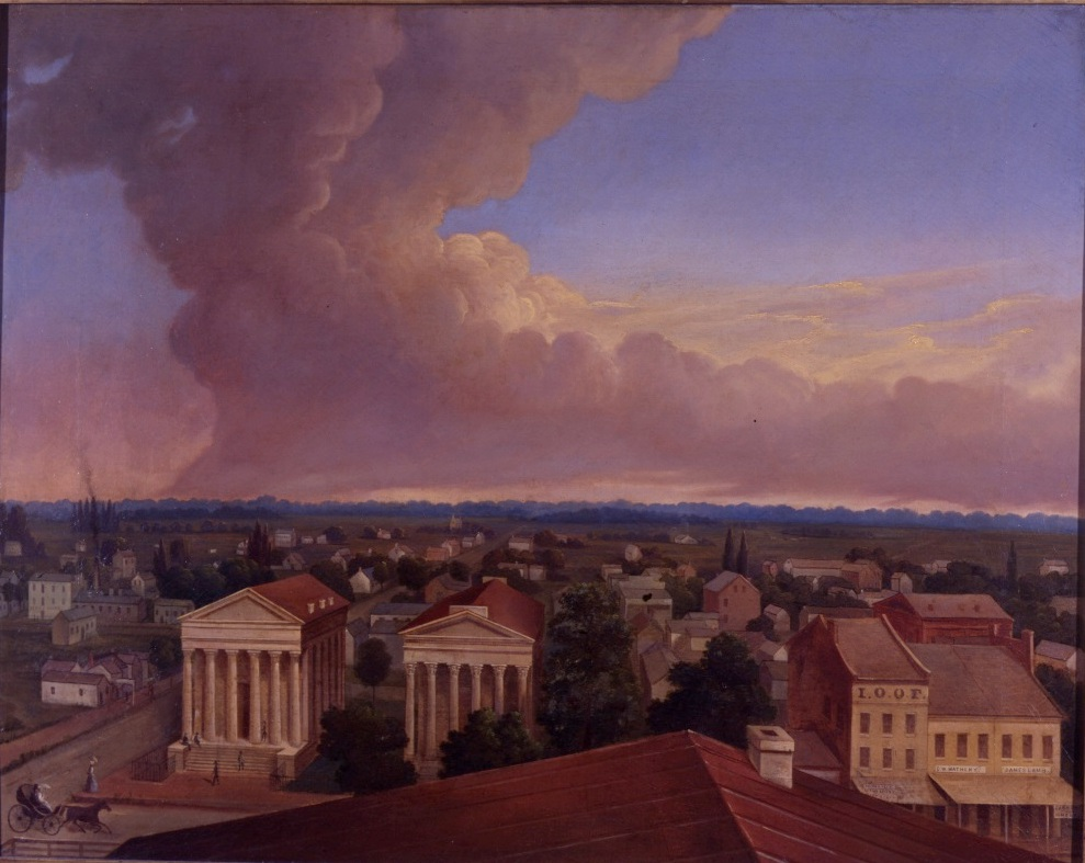 East side of the square; the two columned buildings are, left, the Sangamon County Courthouse and, right, Marine Fire and Casualty Co. (later Springfield Marine Bank). The cloud rising into the sky is said to be smoke from a prairie fire.
