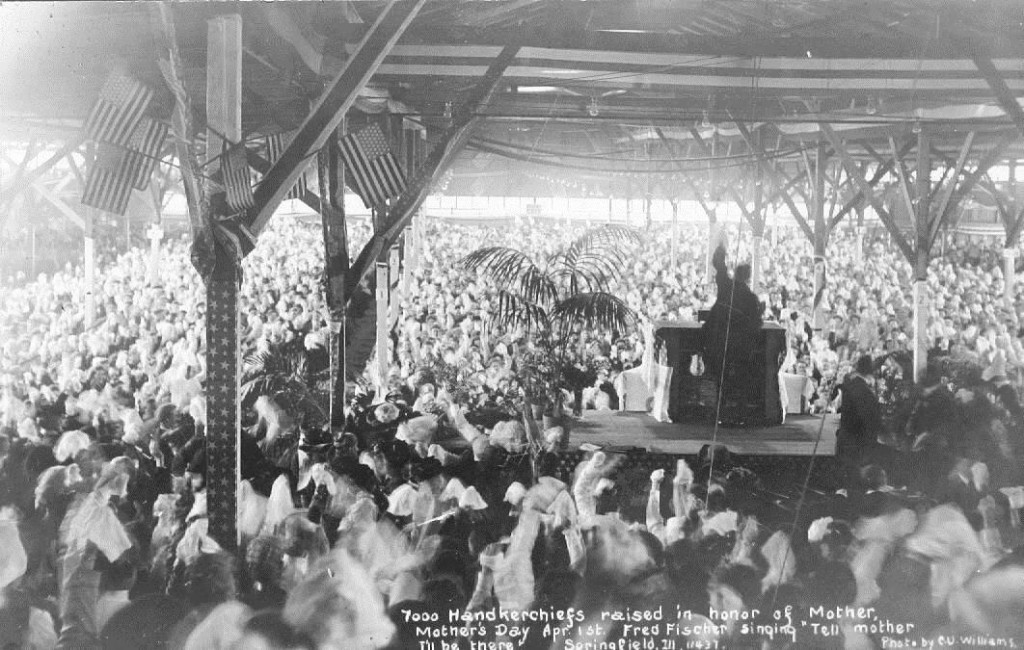 "Billy Sunday's Springfield Tabernacle. Caption reads ""7000 handkerchiefs raised in honor of Mother. Mother's Day Apr. 1st. Fred Fischer singing 'Tell Mother I'll be there' ... Photo by C.U. Williams"""