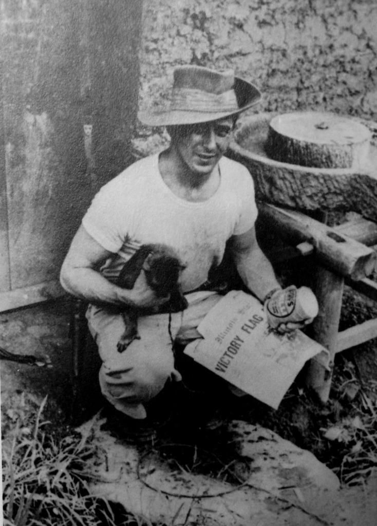 Meredith Rhule with his pet monkey, Dudley, in 1945. The newspaper on Rhule's lap appears to be the May 1, 1945 edition of the Illinois State Journal.