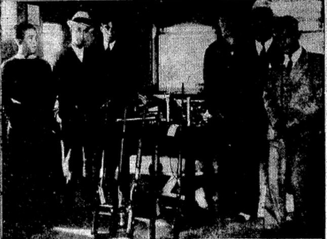 Springfield suspects in the kidnapping of a Peoria banker line up with weapons police seized from them in 1933. From left, Joe Caioli, Tony Campo, Vito Impastato, Charles Fenello, Patsy Aiello, Frank Longo (SJ-R files)