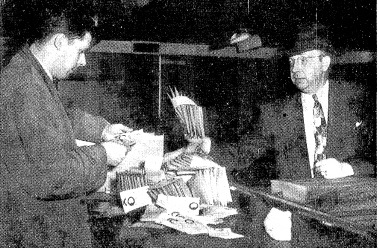 "Asst. state's attorney Robert Oxtoby, left, and sheriff's deputy Ray Crowder inspect gambling ""pull cards"" after a 1951 raid. (SJR files)"