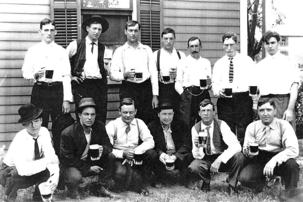 Bartender John Howard is in the top row, third from left, in this photo taken at 1315 E. Enterprise St., next door to the Noll Saloon (Courtesy Kyle Graham)