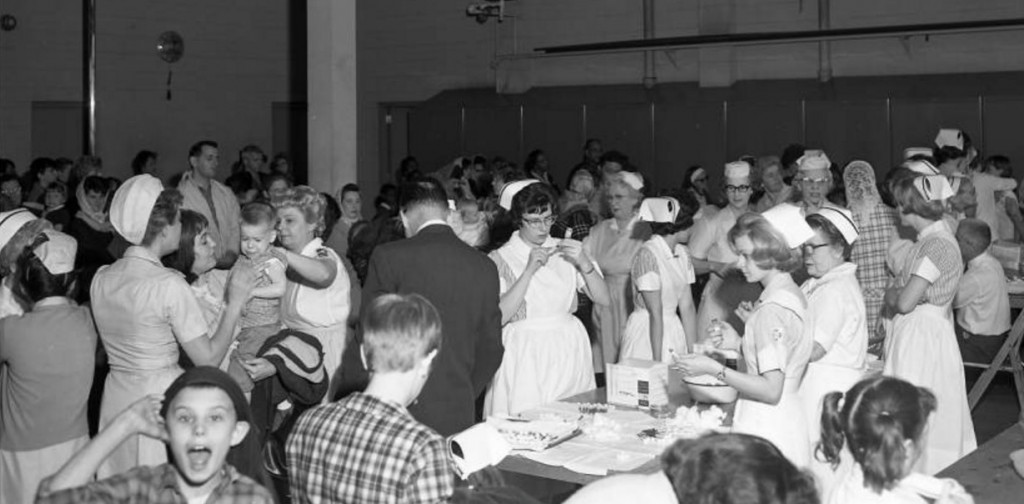 Children and their parents crowd the old Springfield Firehouse No. 1 for free measles vaccinations on March 18, 1966. (Mercury Studios collection, Illinois Digital Archives and Lincoln Library Sangamon Valley Collection)