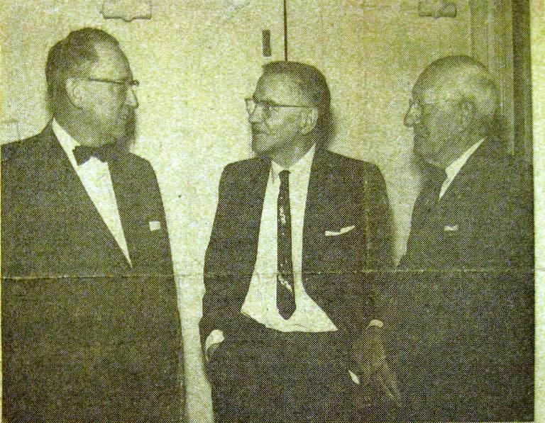 Harold Dewing, center, and Charles Messter, right, talk with Carlin Baker in 1959. Baker, WCBS's first employee, later helped bring WTAX to Springfield. (Sangamon Valley Collection)