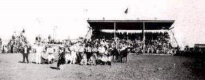 Stapleton Rodeo performers, grandstand in background, undated. (New Berlin, 1865-1965)