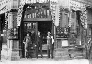 Richard N. Dodds, left, in hat, probably with two employees at door of store, undated (SVC)