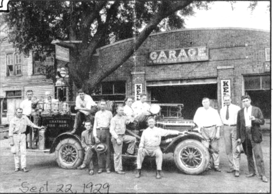 113 W. Mulberry St., Chatham -- then the Everett Cary garage -- is the background of this 1929 photo of the Chatham Fire Department (courtesy Keith Sculle)