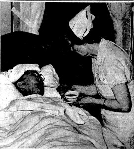 "Jack Lum receives a drink from nurse Anne Squyer following his ""hibernation therapy,"" 1939 (SJR)"