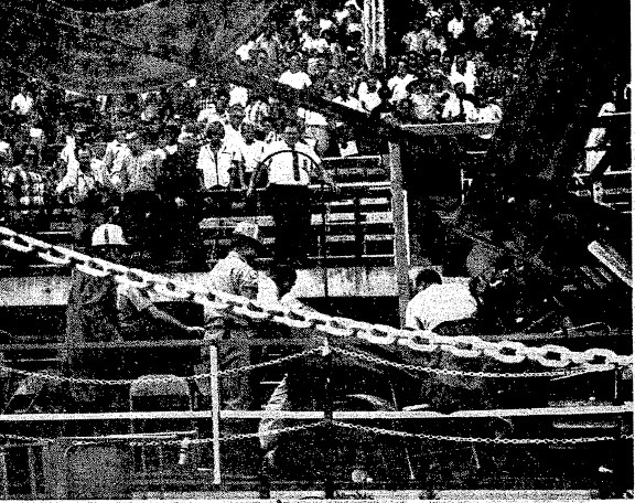Sangamon County Rescue Squad members remove a body from the wreckage of the Illinois State Fair grandstand, Aug. 20, 1966 (SJR)