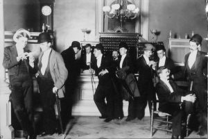 Young men congregate in the Leland Hotel lobby during a Springfield Assembly ball in 1889 (SVC)