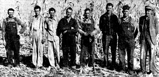Contestants in the 1940 Sangamon County husking contest, from left: Raymond Fry, James Werner, Lee Werner, Claude Bell, Glenn Copelin, Orville Stringfield, Lester Ackerman, John Copelin (SJR)