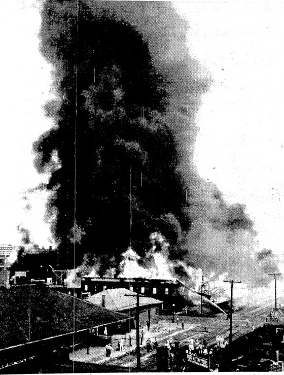 Smoke billows above the Schuck & Sons Lumber Yard, destroyed by fire on Aug. 26, 1937 (SJR)
