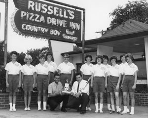 The sign says Russell's, but the logos on the shirts of this champion softball team says Angelo's (Courtesy Sangamon Valley Collection)