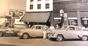 Delivery cars lined up outside the original Twins Corner (Courtesy Saputo's restaurant)