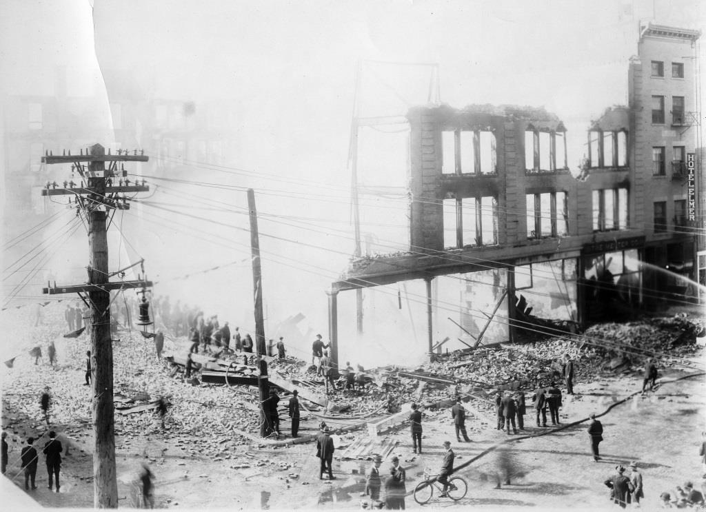 Spectators watch as firefighters extinguish the smoldering ruins of the Johnston-Hatcher Co. home furnishings store after it burnt down for a second time in 1913 (Sangamon Valley Collection)