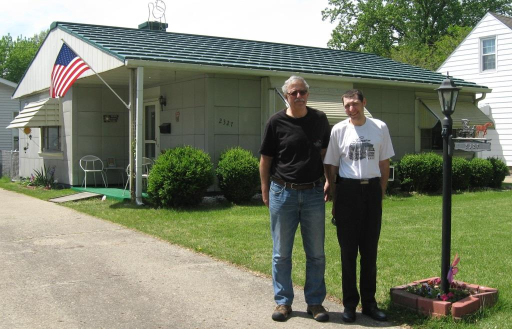 Lustron owners John Weinhoeft, left, and Bryan Weinhoeft in front of Bryan's Lustron, 2327 S. Pasfield St. (SCHS)