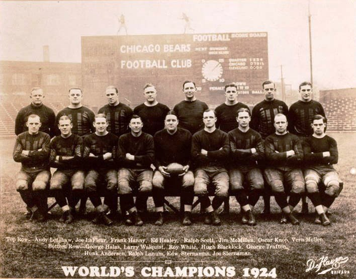"The 1924 Chicago Bears included Dutch Sternaman, second from right in front row, and Joey Sternaman, far right in same row. George Halas is front row, far left. (Despite the ""World Champions"" caption, the Bears finished in second place in 1924) (Wikipedia)"