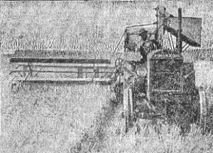 McCormick-Deering tractor-propelled combine in action, 1927