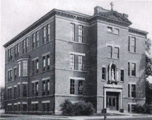 St. Joseph School with three floors and Patrick Henry in the entrance niche (Diamond Jubilee History)