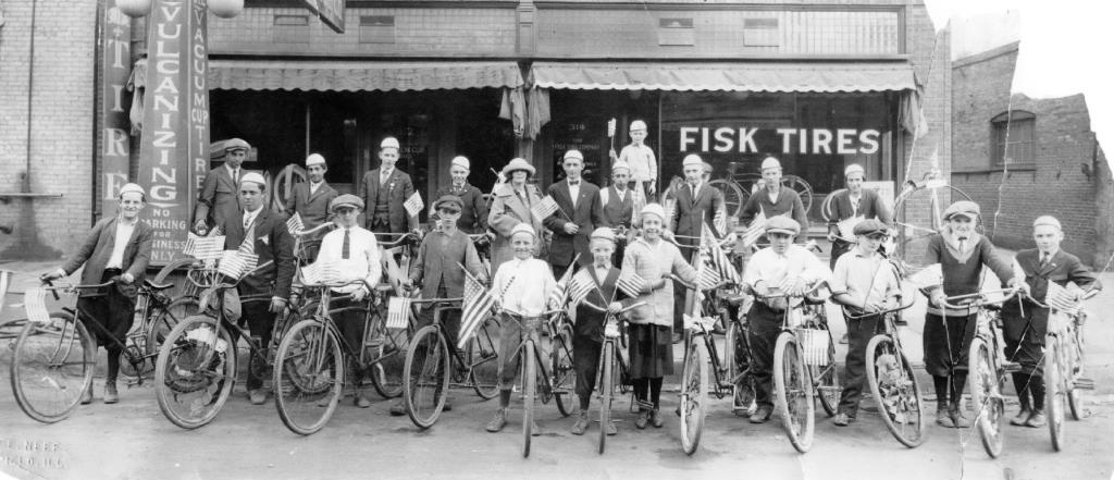 A group of newspaper carriers, with bikes all sporting Fisk tires, pose in front of the Fisk outlet in the 300 block of South Fourth Street, circa 1917. Several of the carriers sport lapel pins that suggest they may have been licensed as street vendors as well. (Sangamon Valley Collection)