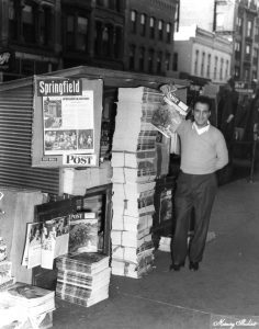 A news stand on Monroe Street east of Fifth Street, 1949 (Sangamon Valley Collection)