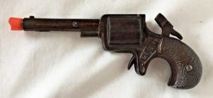 Images of lethal toy pistols from the 1880s are rare, but they probably resembled this 1880s' cap gun (minus the modern orange muzzle plug). Cap guns did not use the dangerous cartridges (eBay)