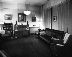 Carrie Post's image hangs above an unused fireplace in the dining room of the home in this undated photo (courtesy King's Daughters Organizatioin)