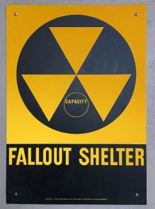 The triangles-within-a-circle were the universal designation for a fallout shelter. (Wikipedia)