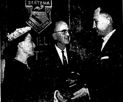 Louisa and Robert Miller received the Service to Mankind Award from the Springfield Sertoma Club in 1961. Sertoma director William Ryder is at right. (Courtesy SJ-R)