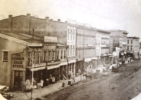 The north side of the downtown square, 1859. No hogs are visible, but dirt still is the predominant feature of Washington Street. (Sangamon Valley Collection)