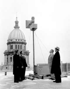 Officials view an installed emergency siren at the Statehouse, 1957 (Courtesy SJ-R)