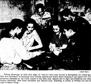 Chinese-American soldiers from the fairgrounds play cards at Springfield's USO center (courtesy SJ-R)