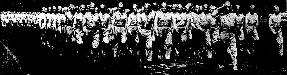 Soldiers stationed at the Illinois State Fairgrounds march in review in Lincoln Park on June 18, 1942 (Courtest State Journal-Register)