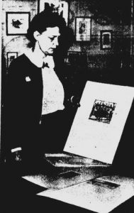 Virginia Stuart Brown in 1941, displaying an etching she had made of the Vachel Lindsay Home (courtesy State Journal-Register)